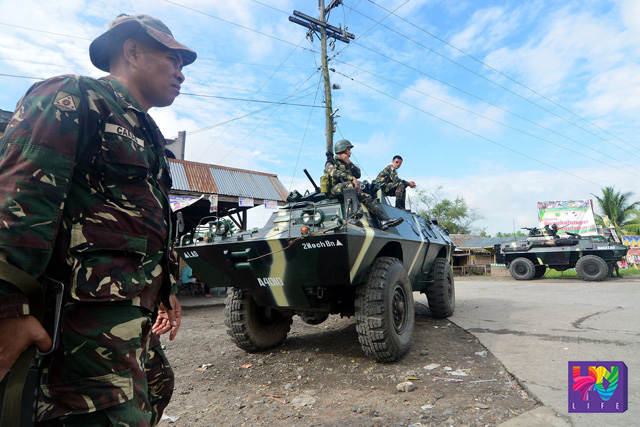 FILE PHOTO: Philippine Army contingent seen on checkpoint at the entry point of Maguindanao province in Buluan, Maguindanao, on May 11, 2013. (Photoville International)