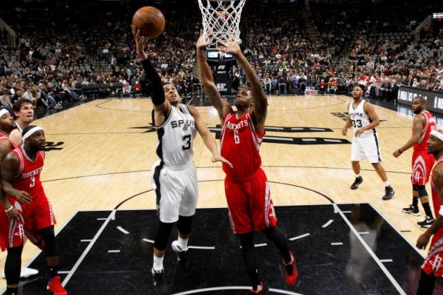 Jan 27, 2016; San Antonio, TX, USA; San Antonio Spurs point guard Ray McCallum (3) shoots the ball as Houston Rockets power forward Terrence Jones (6) defends during the second half at AT&T Center. Mandatory Credit: Soobum Im-USA TODAY Sports