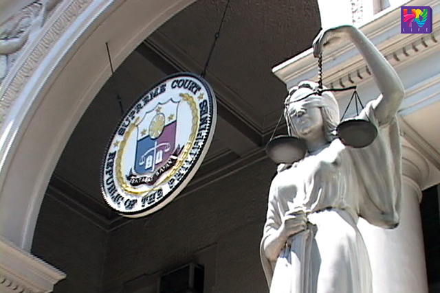 FILE PHOTO: Supreme Court logo and statue of Lady Justice