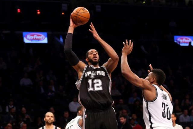 Jan 11, 2016; Brooklyn, NY, USA; San Antonio Spurs forward LaMarcus Aldridge (12) shoots over Brooklyn Nets forward Thaddeus Young (30) during the third quarter at Barclays Center. San Antonio Spurs won 106-79. Mandatory Credit: Anthony Gruppuso-USA TODAY Sports