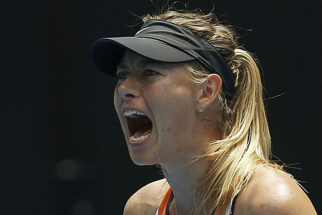 Russia's Maria Sharapova reacts during her quarter-final match against Serena Williams of the U.S. at the Australian Open tennis tournament at Melbourne Park, Australia, January 26, 2016. REUTERS/Issei Kato