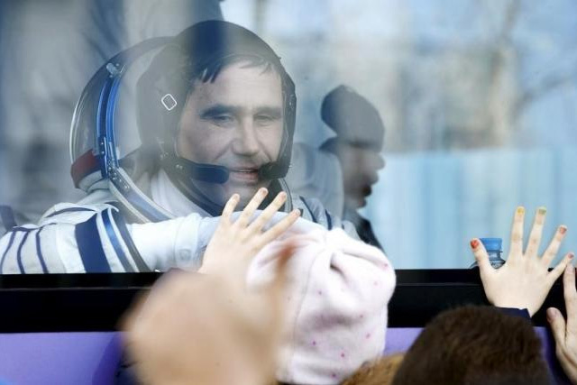 Member of the International Space Station expedition 46/47, Russian cosmonaut Yuri Malenchenko during a sending-off ceremony at the Baikonur cosmodrome in Kazakhstan, 15 December 2015. REUTERS/MAXIM SHIPENKOV/POOL