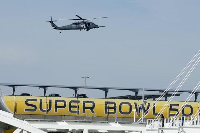 A U.S. military helicopter patrols before NFL Super Bowl 50 outside Levi's Stadium in Santa Clara, California, United States, February 6, 2016. REUTERS/Mike Blake