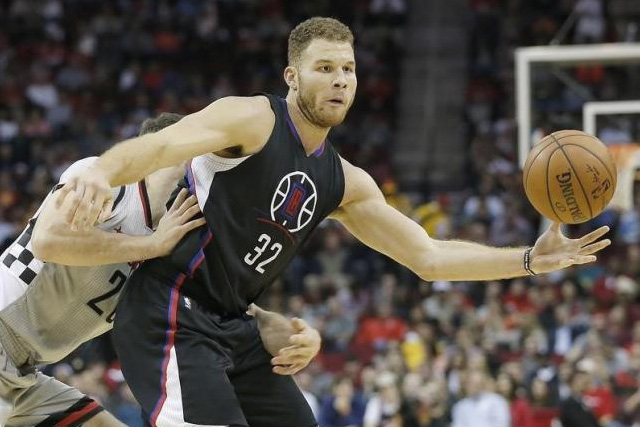 Dec 19, 2015; Houston, TX, USA; Los Angeles Clippers forward Blake Griffin (32) is defended by Houston Rockets forward Donatas Motiejunas (20) in the second half at Toyota Center. Rockets won 107 to 97. Mandatory Credit: Thomas B. Shea-USA TODAY Sports