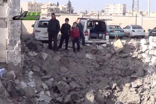 People gather near what is said to be a hospital damaged by missile attacks in Azaz, Aleppo, Syria, February 15, 2016 in this still image taken from a video on a social media website. REUTERS/Social Media Website via Reuters TV