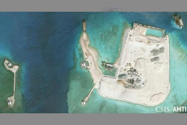 The artificial island at the southern end of Mischief Reef showing a newly-built seawall on its north side and a completed dock are shown in this Center for Strategic and International Studies (CSIS) Asia Maritime Transparency Initiative January 8, 2016 satellite image... REUTERS/CSIS ASIA MARITIME TRANSPARENCY INITIATIVE/DIGITAL GLOBE/HANDOUT VIA REUTERS/FILES