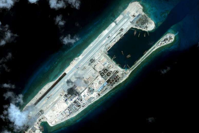 Fiery Cross Reef, also known as Yongshu Reef, located on the disputed Spratly Islands in the South China Sea. Vietnam has protested against China's flight to the airfield on the reef, saying this encroaches on its sovereignty.PHOTO: REUTERS