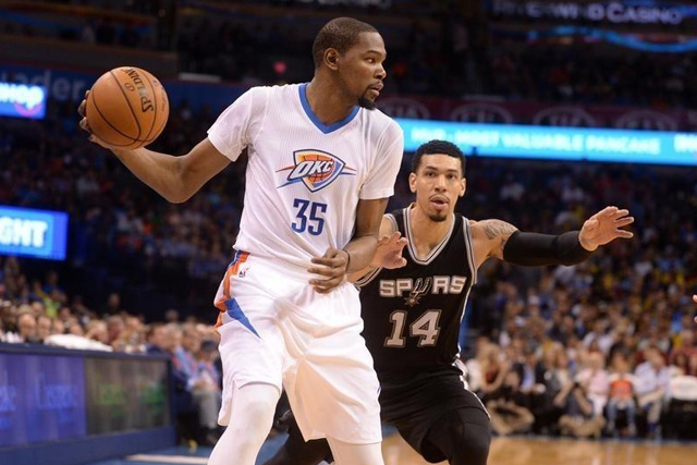 Mar 26, 2016; Oklahoma City, OK, USA; Oklahoma City Thunder forward Kevin Durant (35) fights for position agains tSan Antonio Spurs guard Danny Green (14) during the second quarter at Chesapeake Energy Arena. Mandatory Credit: Mark D. Smith-USA TODAY Sports -