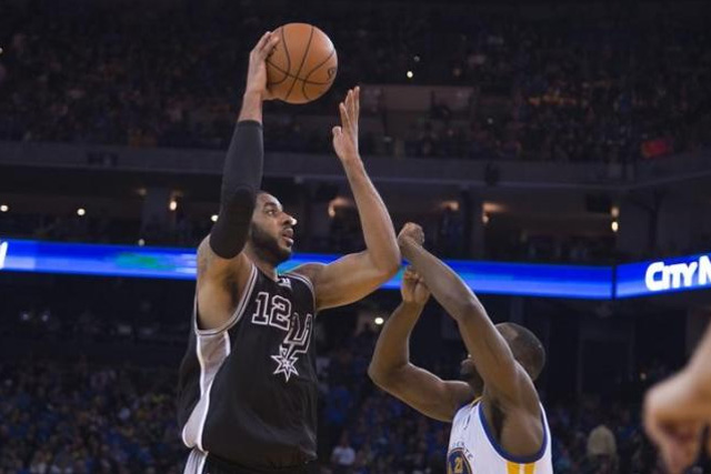 January 25, 2016; Oakland, CA, USA; File photo of San Antonio Spurs forward LaMarcus Aldridge (12) shooting the basketball against Golden State Warriors forward Draymond Green (23) during the third quarter at Oracle Arena. Mandatory Credit: Kyle Terada-USA TODAY Sports