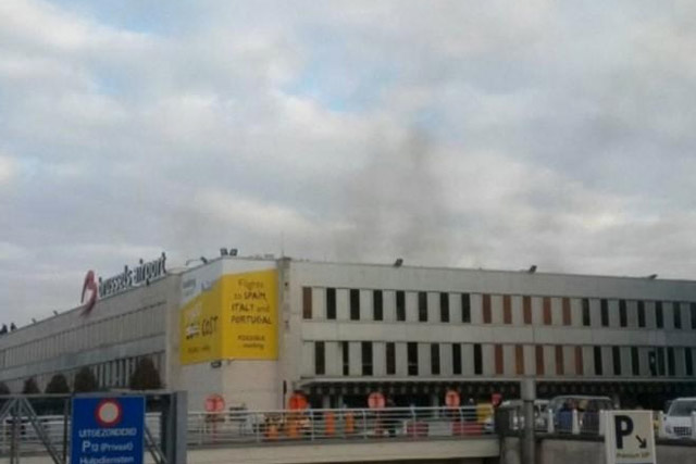 Black smoke is seen rising from the Brussels airport following explosions, in this still image made available March 22, 2016. REUTERS/Peter van Rossum via Reuters TV