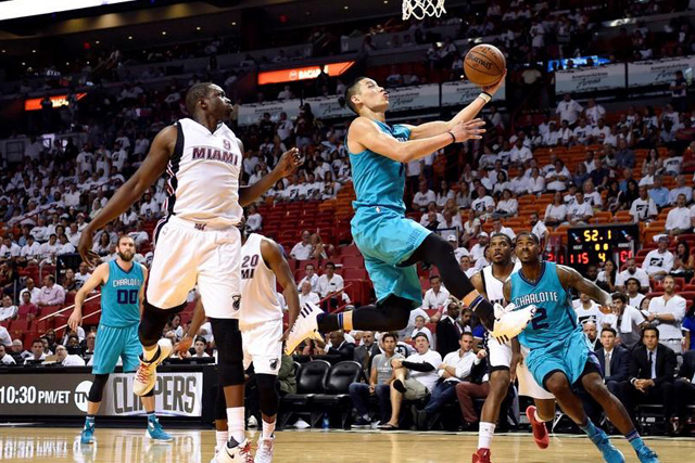 Wednesday, April 20, 2016 Charlotte Hornets guard Jeremy Lin (7) shoots the ball in front of Miami Heat forward Luol Deng (9) in game two of the first round of the NBA Playoffs during the fourth quarter at American Airlines Arena. The Heat won 115-103. Mandatory Credit: Steve Mitchell-USA TODAY Sports