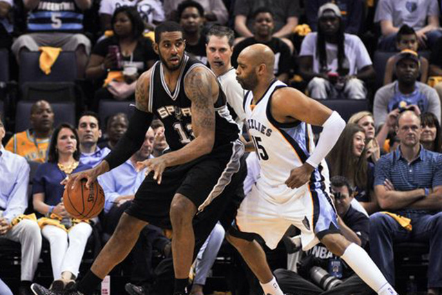 Apr 24, 2016; Memphis, TN, USA; San Antonio Spurs forward LaMarcus Aldridge (12) posts up against Memphis Grizzlies guard Vince Carter (15) during the first half in game four of the first round of the NBA Playoffs at FedExForum. Mandatory Credit: Justin Ford-USA TODAY Sports
