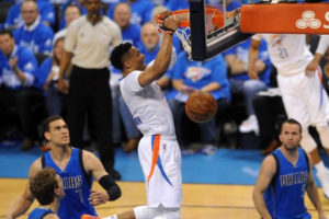 Apr 25, 2016; Oklahoma City, OK, USA; Oklahoma City Thunder guard Russell Westbrook (0) dunks the ball in front of Dallas Mavericks forward Dirk Nowitzki (41) during the first quarter in game five of the first round of the NBA Playoffs at Chesapeake Energy Arena. Mark D. Smith-USA TODAY Sports