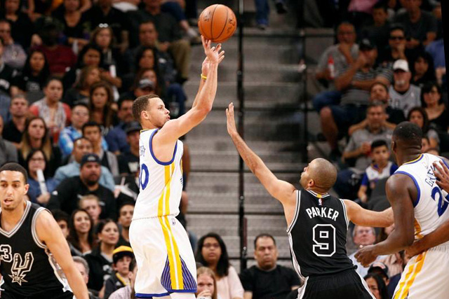 Apr 10, 2016; San Antonio, TX, USA; Golden State Warriors point guard Stephen Curry (30) shoots the ball over San Antonio Spurs point guard Tony Parker (9) during the first half at AT&T Center. Soobum Im-USA TODAY Sports
