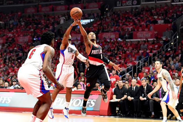 Monday, April 18, 2016 Apr 17, 2016; Los Angeles, CA, USA; Portland Trail Blazers guard Damian Lillard (0) shoots against Los Angeles Clippers guard Chris Paul (3) during the first half in game one of the first round of the NBA Playoffs at Staples Center. Richard Mackson-USA TODAY Sports