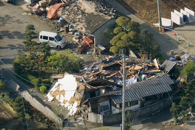 Thursday, April 14, 2016 Collapsed houses caused by an earthquake are seen in Mashiki town, Kumamoto prefecture, southern Japan, in this photo taken by Kyodo April 15, 2016. Mandatory credit REUTERS/Kyodo