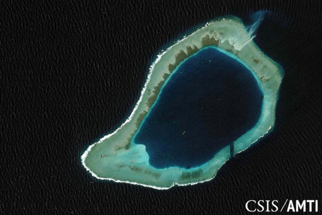 Subi reef, located in the disputed Spratly Islands in the South China Sea, is shown in this handout Center for Strategic and International Studies (CSIS) Asia Maritime Transparency Initiative satellite file image taken August 8, 2012, and released to Reuters October 27,... REUTERS/CSIS ASIA MARITIME TRANSPARENCY INITIATIVE/DIGITALGLOBE/HANDOUT VIA REUTERS/FILES