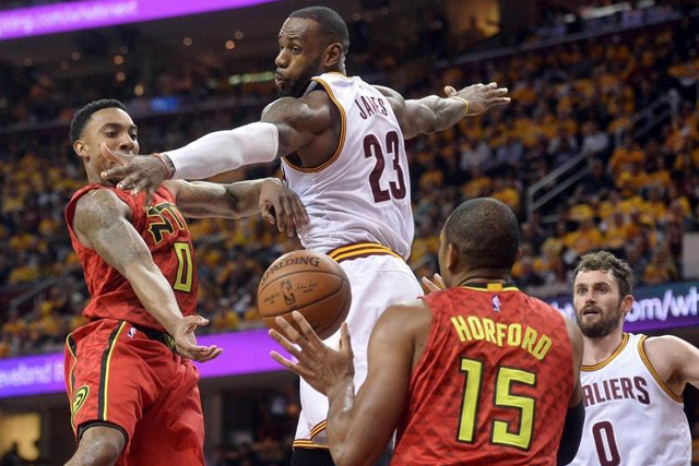 Monday, May 02, 2016 Atlanta Hawks guard Jeff Teague (0) passes to center Al Horford (15) as Cleveland Cavaliers forward LeBron James (23) defends during the second half in game one of the second round of the NBA Playoffs at Quicken Loans Arena. The Cavs won 104-93. Mandatory Credit: Ken Blaze-USA TODAY Sports