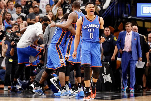 Tuesday, May 03, 2016 Oklahoma City Thunder point guard Russell Westbrook (0) and teammates celebrate a victory over the San Antonio Spurs in game two of the second round of the NBA Playoffs at AT&T Center. Mandatory Credit: Soobum Im-USA TODAY Sports
