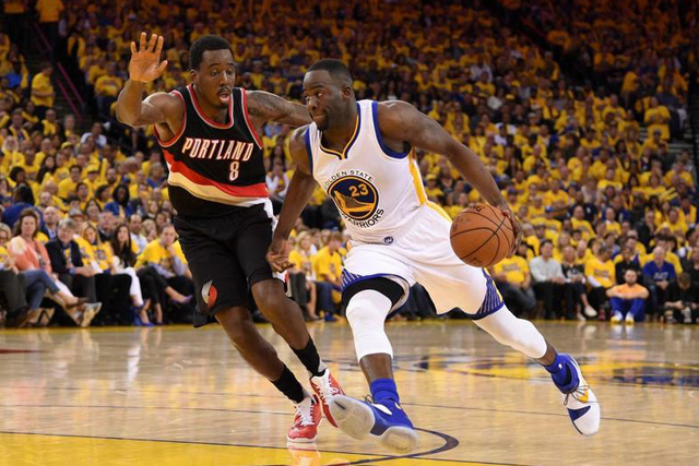 Wednesday, May 04, 2016 Golden State Warriors forward Draymond Green (23) dribbles the basketball against Portland Trail Blazers forward Al-Farouq Aminu (8) during the third quarter in game two of the second round of the NBA Playoffs at Oracle Arena. The Warriors defeated the Trail Blazers 110-99. Mandatory Credit: Kyle Terada-USA TODAY Sports