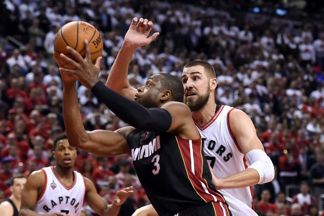 Tuesday, May 03, 2016 Miami Heat guard Dwyane Wade (3) shoots past Toronto Raptors guard Jonas Valanciunas (17) in game one of the second round of the NBA Playoffs at Air Canada Centre. The Heat won 102 -96 in overtime. Mandatory Credit: Dan Hamilton-USA TODAY Sports
