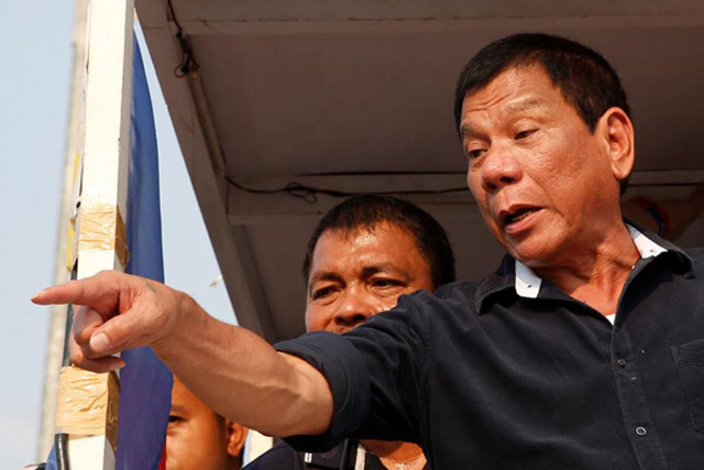 "Wednesday, May 04, 2016 Presidential candidate Rodrigo ""Digong"" Duterte greets supporters during election campaigning in Malabon, Metro Manila in the Philippines April 27, 2016. REUTERS/Erik De Castro"
