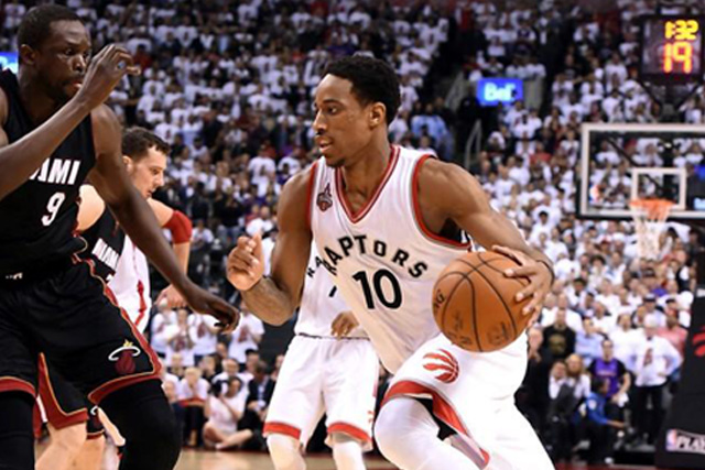 Friday, May 06, 2016 Toronto Raptors guard DeMar DeRozan (10) dribles the ball past Miami Heat forward Luol Deng (9) in game two of the second round of the NBA Playoffs at Air Canada Centre. The Raptors won 96-92. Mandatory Credit: Dan Hamilton-USA TODAY Sports