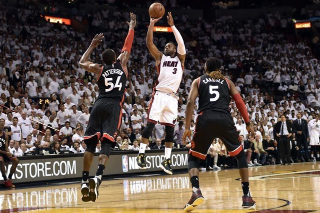 Tuesday, May 10, 2016 May 9, 2016; Miami, FL, USA; Miami Heat guard Dwyane Wade (3) shoots over Toronto Raptors forward Patrick Patterson (54) during the fourth quarter in game four of the second round of the NBA Playoffs at American Airlines Arena. The Heat won in overtime 94-87. Mandatory Credit: Steve Mitchell-USA TODAY Sports