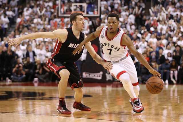Wednesday, May 11, 2016 May 11, 2016; Toronto, Ontario, CAN; Toronto Raptors point guard Kyle Lowry (7) drives to the basket past Miami Heat point guard Goran Dragic (7) in game five of the second round of the NBA Playoffs at Air Canada Centre. The Raptors beat the Heat 99-91. Mandatory Credit: Tom Szczerbowski-USA TODAY Sports