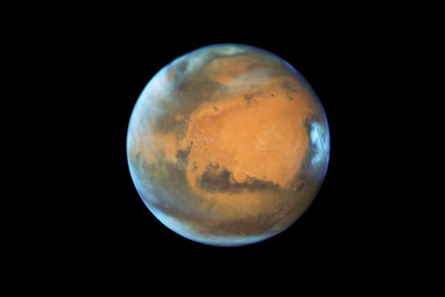 The planet Mars is shown May 12, 2016 in this NASA Hubble Space Telescope view taken May 12, 2016 when it was 50 million miles from Earth. Earth's neighbor planet makes its closest approach in a decade this month, providing sky-watchers with a celestial show from dusk to...
