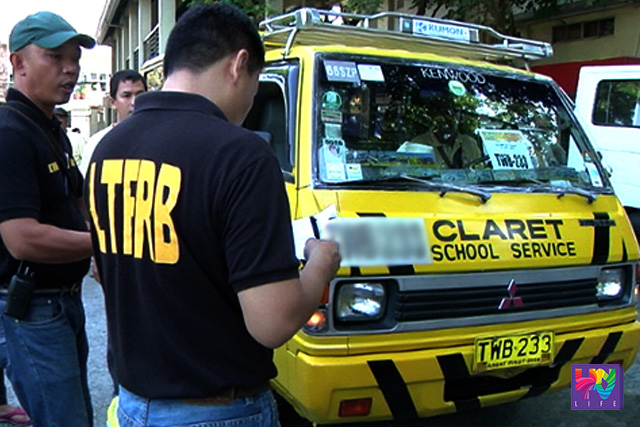 LTFRB personnel inspects a school bus.