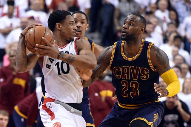 Monday, May 23, 2016 May 23, 2016; Toronto, Ontario, CAN; Toronto Raptors guard DeMar DeRozan (10) holds the ball away from Cleveland Cavaliers forward LeBron James (23) in game four of the Eastern conference finals of the NBA Playoffs at Air Canada Centre. The Raptors won 105-99. Mandatory Credit: Dan Hamilton-USA TODAY Sports