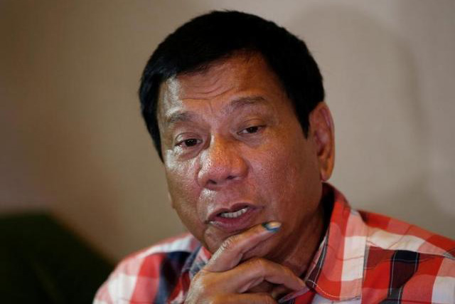 Presidential candidate Rodrigo ''Digong'' Duterte talks to reporters in Davao city in southern Philippines, May 9, 2016. REUTERS/ERIK DE CASTRO
