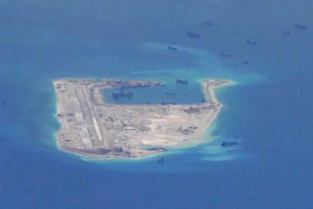 Chinese dredging vessels are purportedly seen in the waters around Fiery Cross Reef in the disputed Spratly Islands in the South China Sea in this still image from video taken by a P-8A Poseidon surveillance aircraft provided by the United States Navy May 21, 2015. U.S....