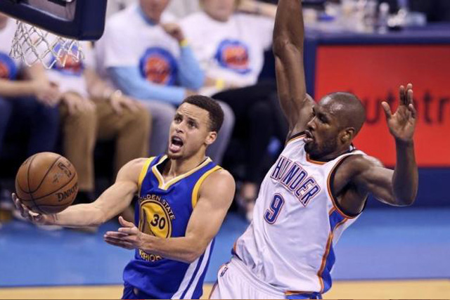 May 24, 2016; Oklahoma City, OK, USA; Golden State Warriors guard Stephen Curry (30) shoots past Oklahoma City Thunder forward Serge Ibaka (9) during the second quarter in game four of the Western conference finals of the NBA Playoffs at Chesapeake Energy Arena. Mandatory...