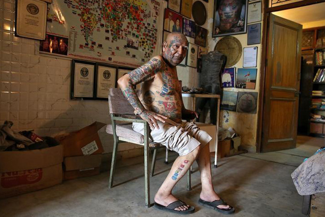 Thursday, May 26, 2016 Guinness Rishi, 74, multiple world record holder including most flags tattooed on his body, is pictured inside his apartment in New Delhi, India May 20, 2016. REUTERS/Cathal McNaughton