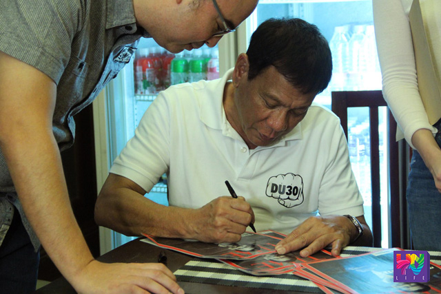 Incoming president Rodrigo Duterte signs a copy of Time Magazine where he is on the cover page. (UNTV NEWS/CERILO EBRANO -PHOTOVILLE INTERNATIONAL)