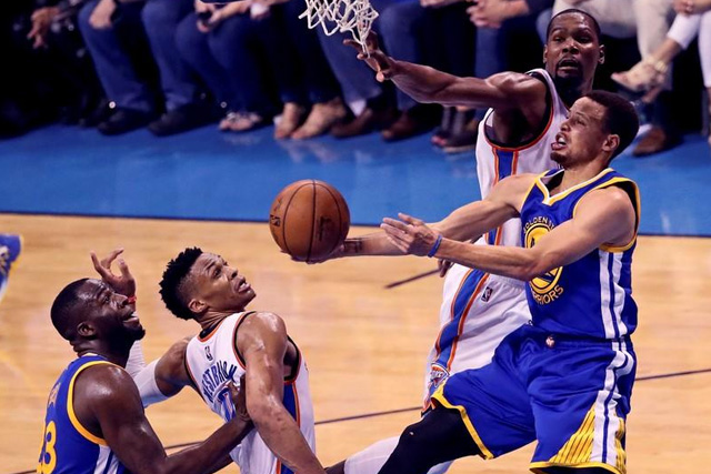 May 28, 2016; Oklahoma City, OK, USA; Golden State Warriors guard Stephen Curry (30) shoots around Oklahoma City Thunder forward Kevin Durant (35) and guard Russell Westbrook (0) during the second half in game six of the Western conference finals of the NBA Playoffs at Chesapeake Energy Arena. Mandatory Credit: Kevin Jairaj-USA TODAY Sports