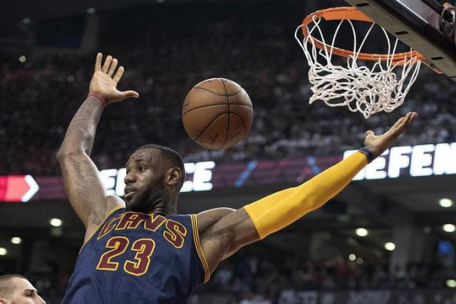 May 27, 2016; Toronto, Ontario, CAN; Cleveland Cavaliers forward LeBron James (23) scores a basket during the third quarter of game six of the Eastern conference finals of the NBA Playoffs against the Toronto Raptors at Air Canada Centre. Mandatory Credit: Nick...