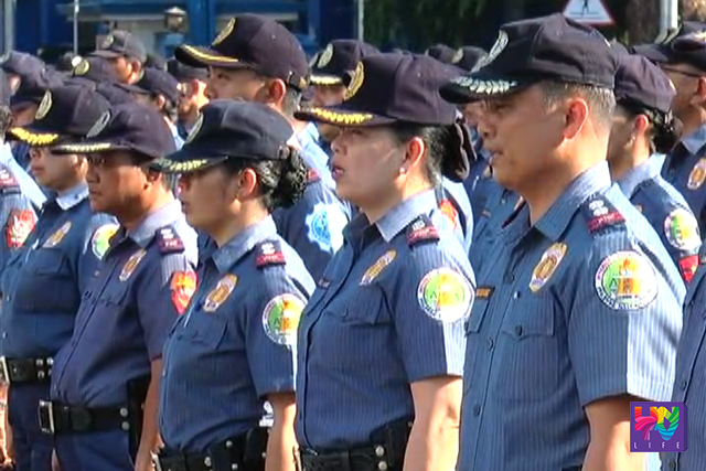 PNP personnel in queue.
