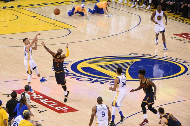 Thursday, June 02, 2016 Golden State Warriors guard Stephen Curry (30) shoots against Cleveland Cavaliers guard Kyrie Irving (2) during the second half in game one of the NBA Finals at Oracle Arena. Mandatory Credit: Kyle Terada-USA TODAY Sports