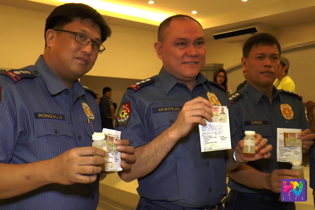 Three PNP officials pose in a photo showing their specimen in a surprise drug testing in Laguna. (UNTV NEWS)