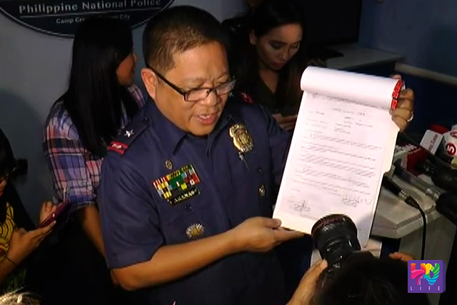 PNP Crime Lab Director PCSupt. Emmanuel Aranas shows the autopsy, histopathology and toxicology report regarding the death of two rave party victims. (UNTV NEWS)