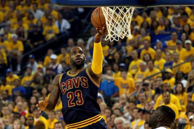 Jun 5, 2016; Oakland, CA, USA; Cleveland Cavaliers forward LeBron James (23) shoots the ball against Golden State Warriors forward Draymond Green (23) during the first quarter in game two of the NBA Finals at Oracle Arena. Mandatory Credit: Bob Donnan-USA TODAY Sports