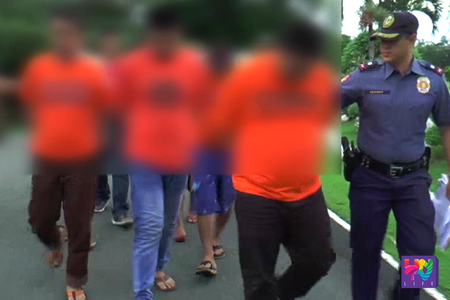 Three arrested drug dealers are escorted by PNP personnel on their way to Camp Vicente Lim on Tuesday, June 7, 2016. (UNTV NEWS)