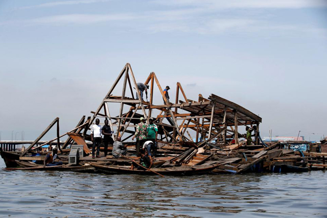 Wednesday, June 08, 2016 Residents work to dismantle the Makoko floating school after it collapsed in the Makoko fishing community on the Lagos lagoon, Nigeria June 8, 2016. No casuality was recorded in the incident. REUTERS/Akintunde Akinleye