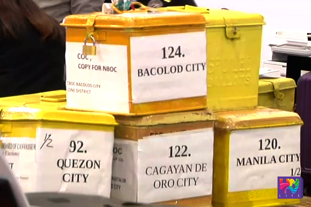 Labeled ballot boxes in different provinces are piled up in a file photo. (UNTV NEWS)
