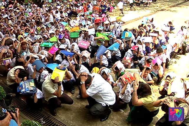 Students, teachers and faculty members  do the Dock, Cover and Hold position in an earthquake drill done in V.E. Fugoso Memorial School in Marikina City on Wednesday, June 15, 2016.