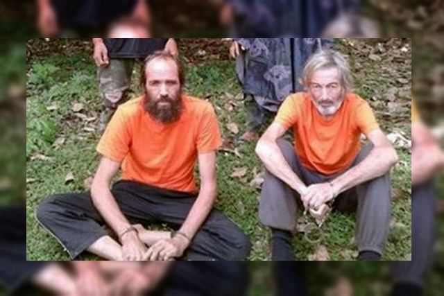 Hostages Canadian national Robert Hall (R) and Norwegian national Kjartan Sekkingstad (L) are seen in this undated picture released to local media, in Jolo island in southern Philippines. Handout/ via REUTERS