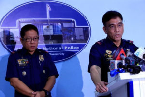 Wednesday, June 15, 2016 Philippine National Police (PNP) public information office Chief PCSupt. Wilben Mayor (R) with PNP Crime Lab Director PCSupt Emmanuel Aranas, answer questions during a news conference inside the police headquarters in metro Manila, Philippines June 14, 2016, following the execution of hostage Canadian Robert Hall. REUTERS/Romeo Ranoco